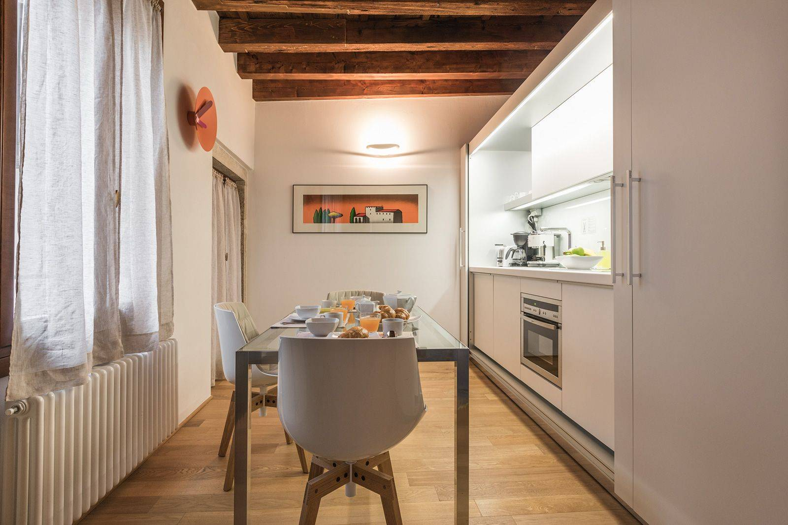 the kitchen can be hidden completely using sliding doors
