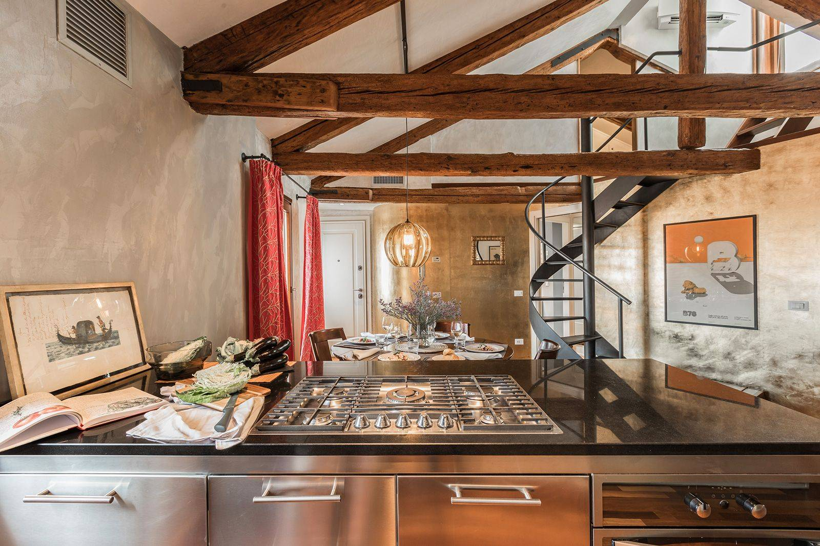 the stylish steel kitchen fits perfectly in the traditional Venetian architecture
