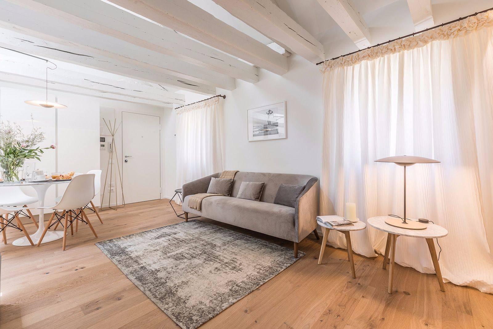 nice parquet flooring, wooden beams, designer furniture