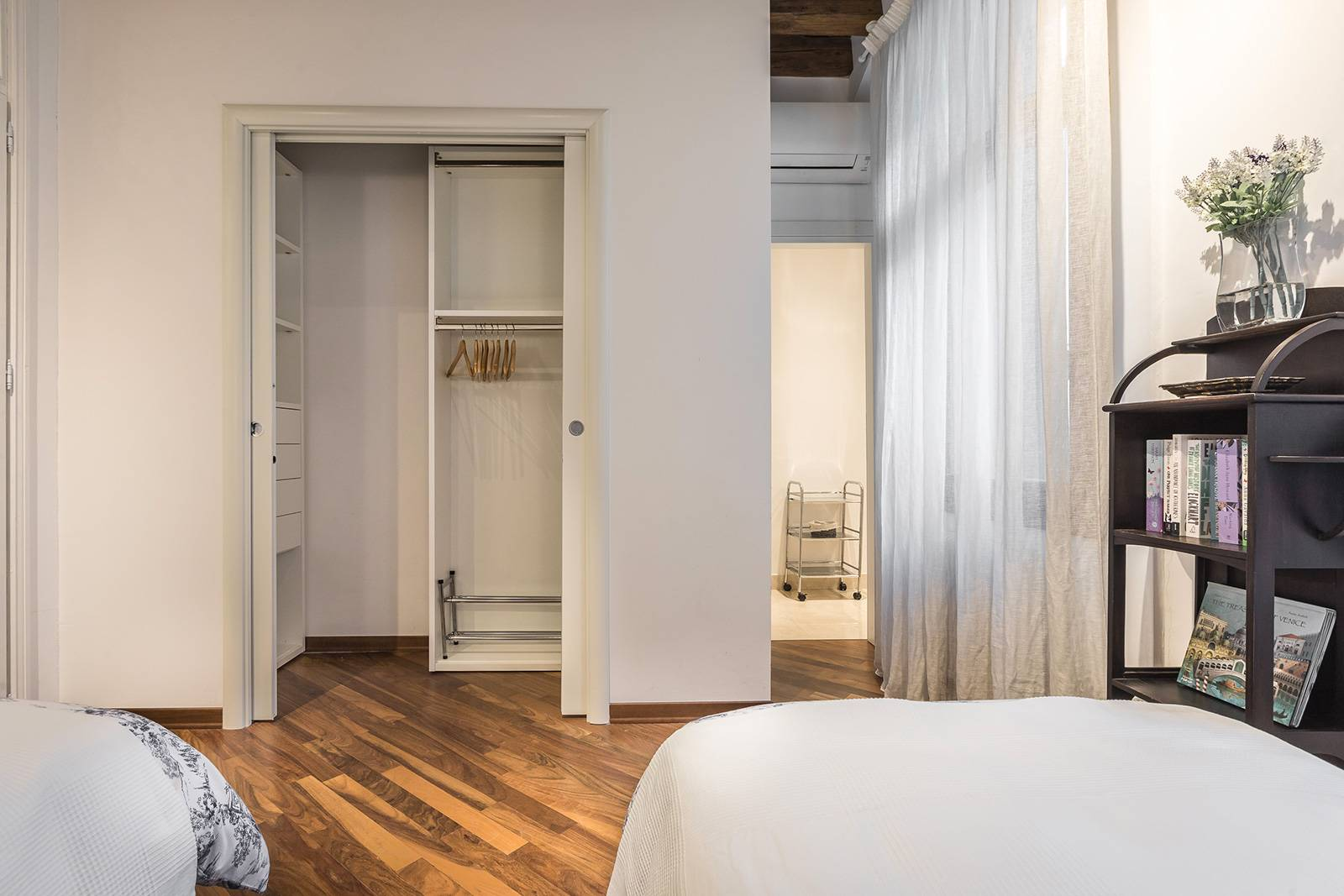 there is a walk-in wardrobe with sliding doors