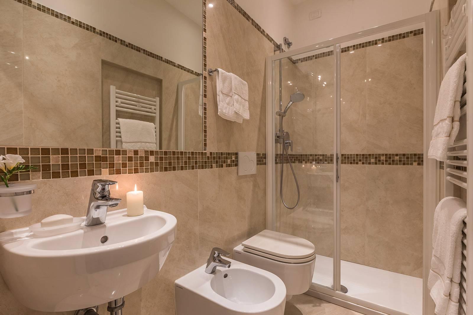 the smaller bathroom accessible from the corridor