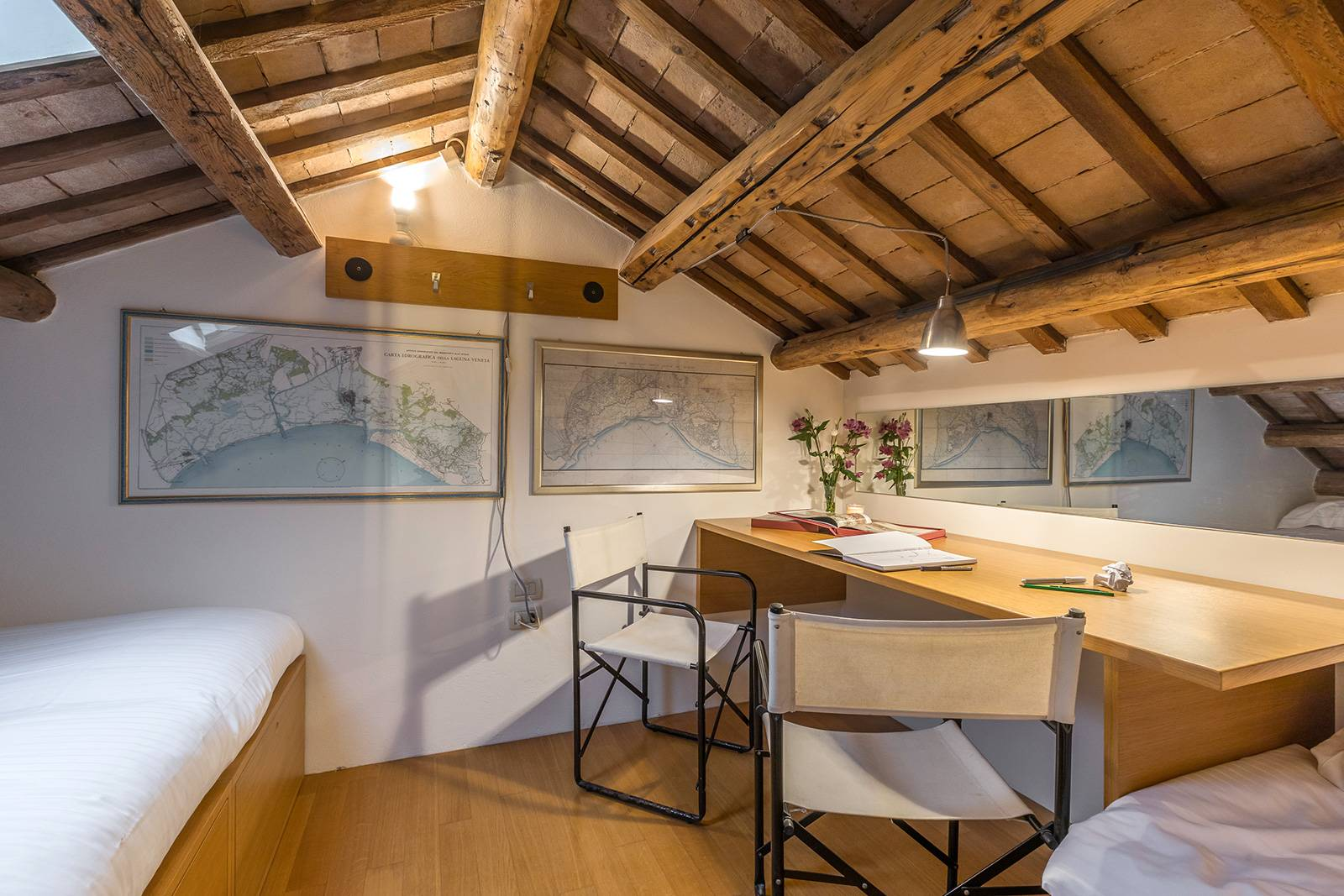 the cosy attic can be used as a second bedroom or as an office/playroom