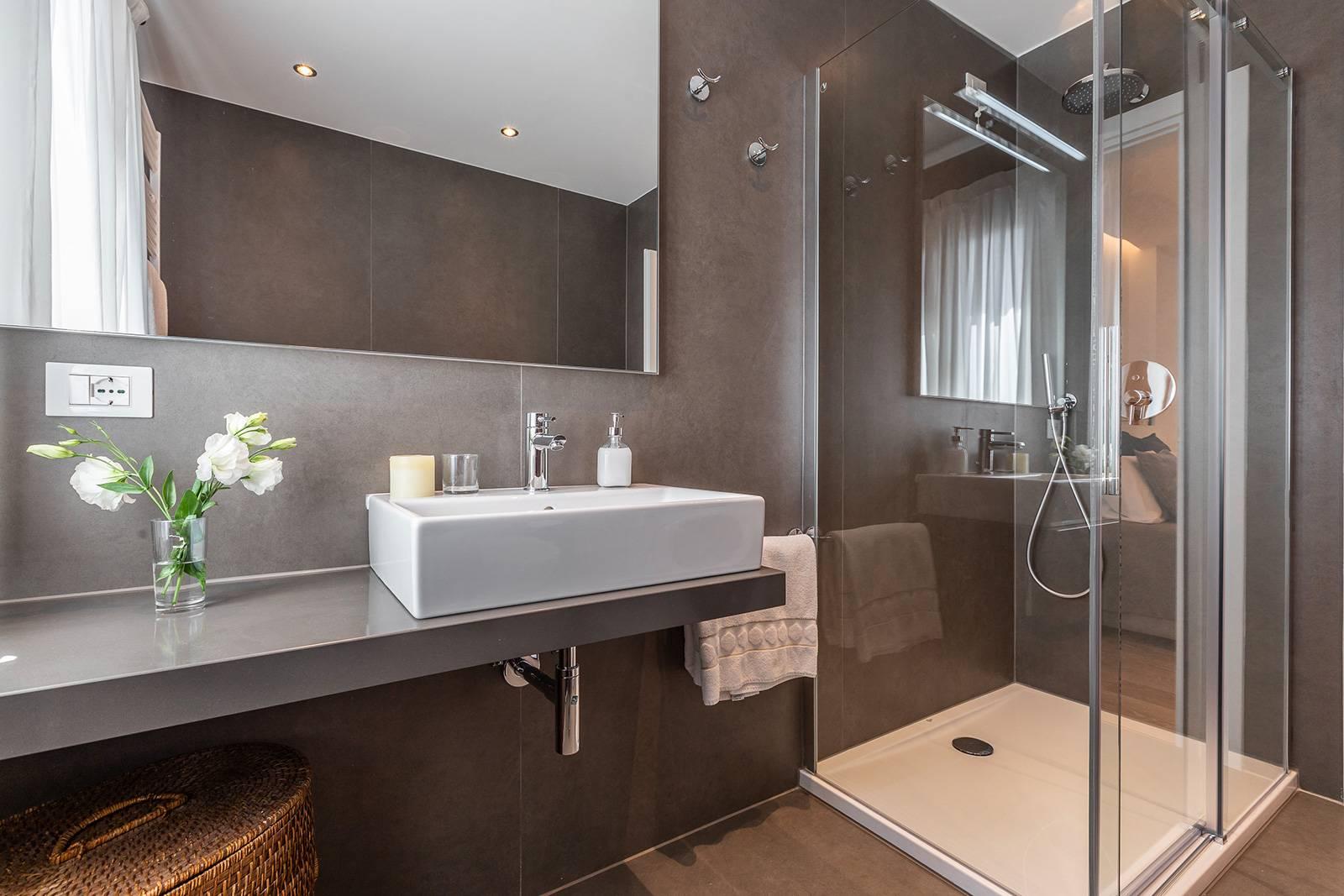 luxury en-suite bathroom with large shower cabin