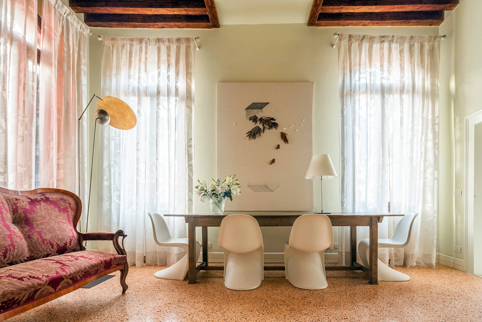 high celings, wooden beams, terrazzo Veneziano looring, designer furniture...