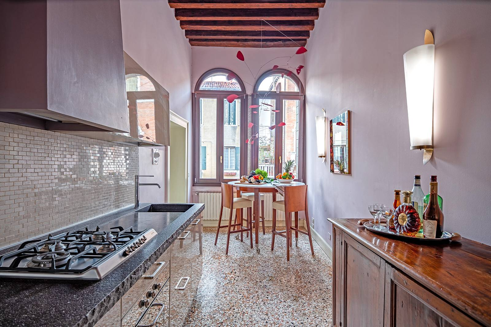 the kitchen is compact but fully equipped with top of the line appliances