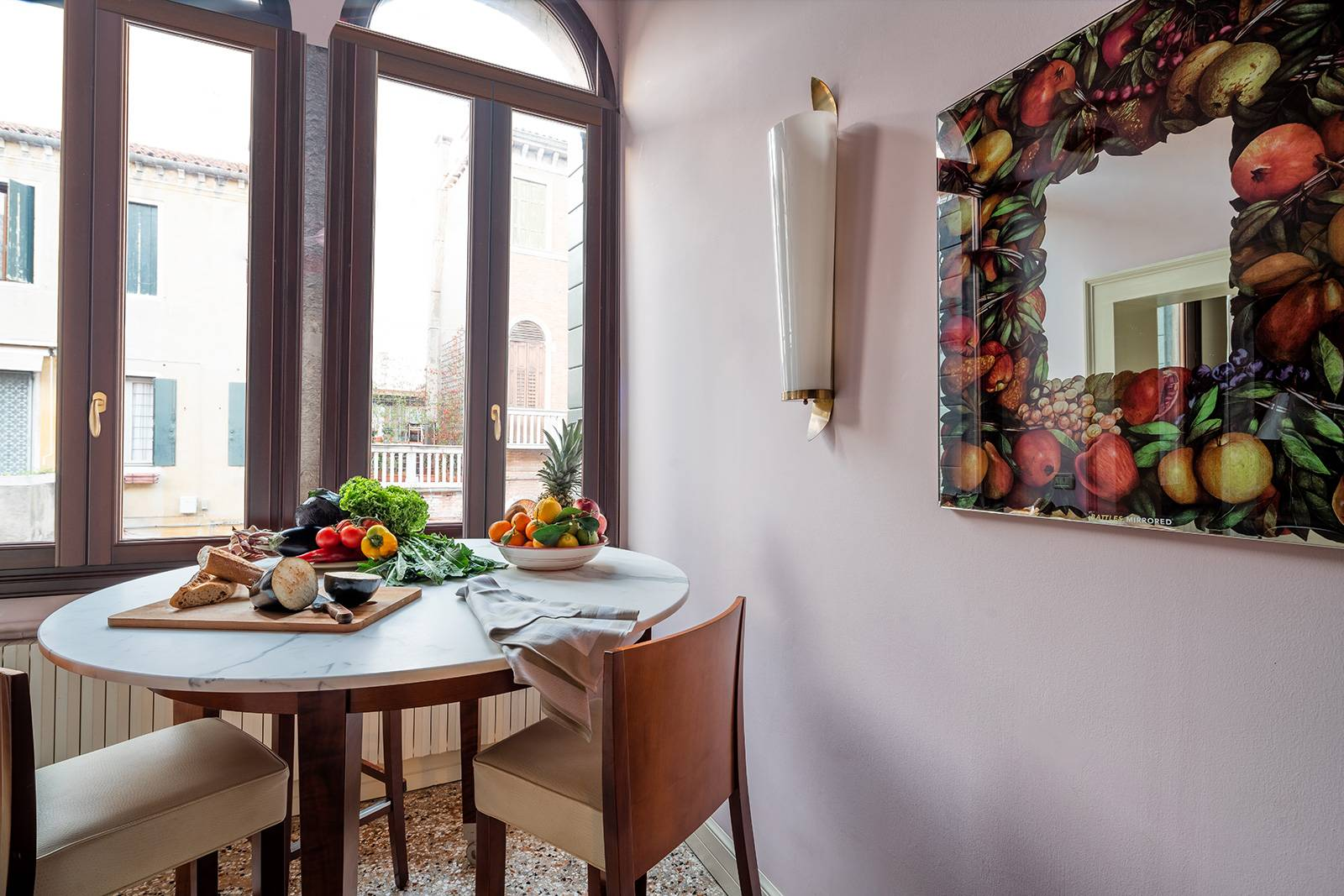 """there is a high table for 4 people with canal view next to the """"Bifora"""" window"""