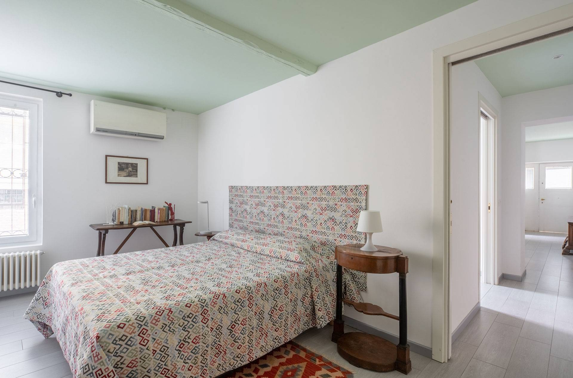 spacious double bedroom with king size bed and antique furniture