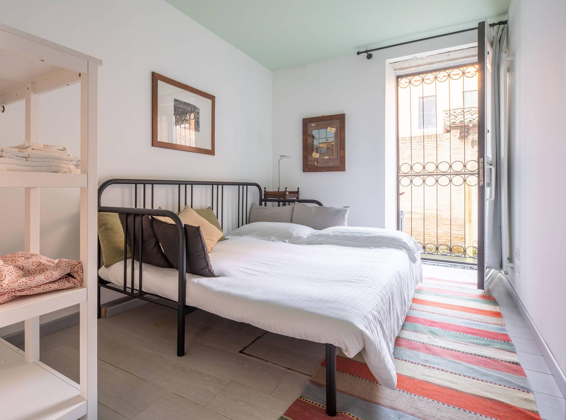 second bedroom with double sofa-bed and water door