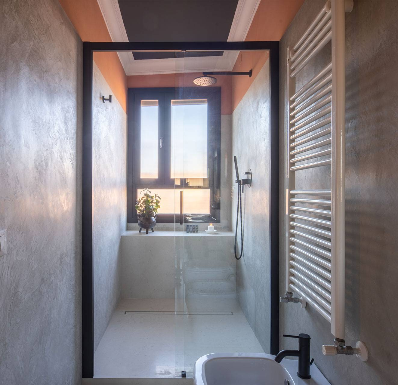 there is a large shower cabin with view on the rooftops