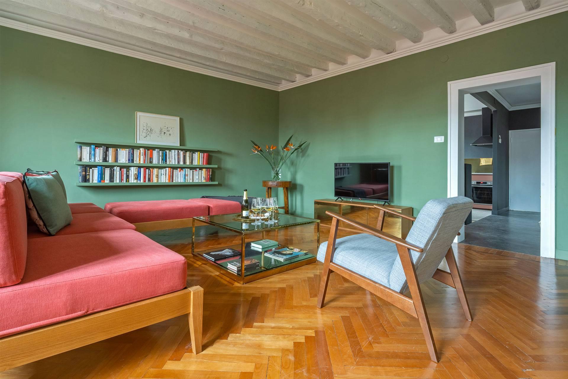 wooden beamed ceiling, fishbone parquet flooring, mid century design furniture