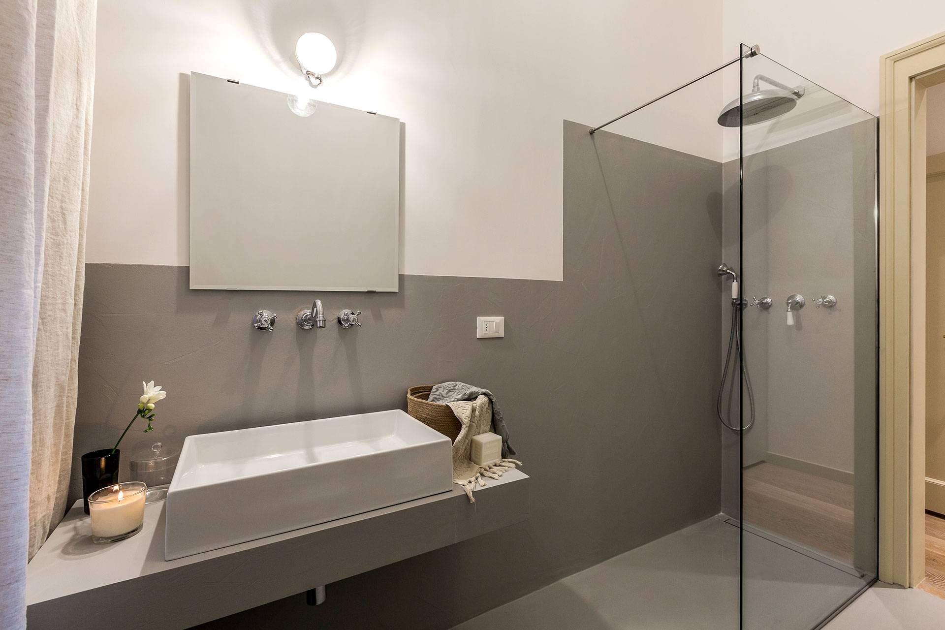 spacious bathroom with large shower cabin