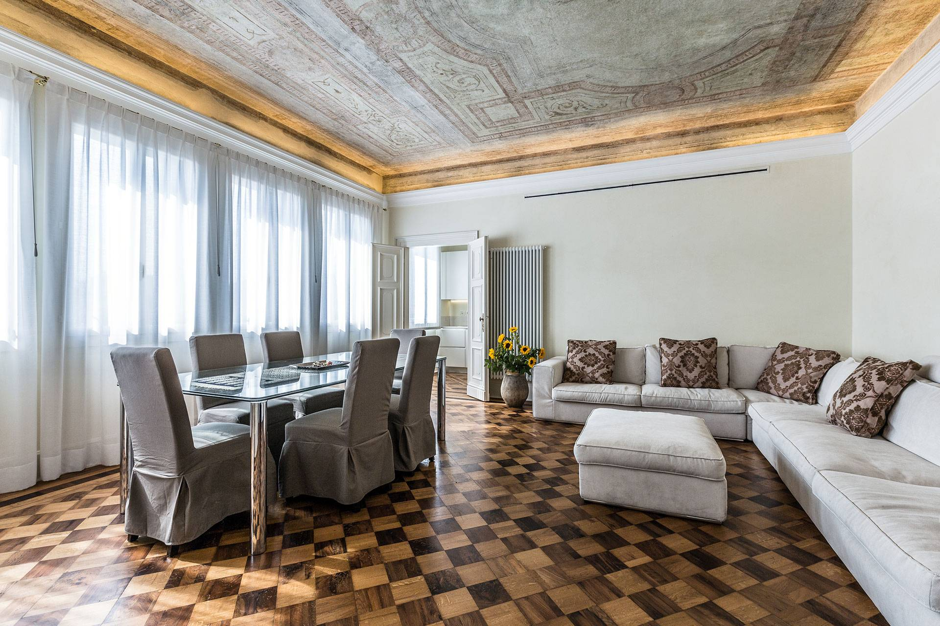 """the luxurious living and dining room of the Alighieri """"B"""""""