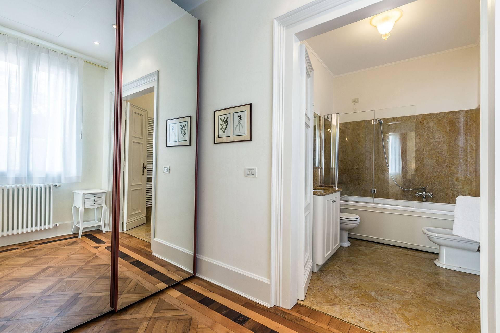 walk-in wardrobe between the bedroom and the bathroom