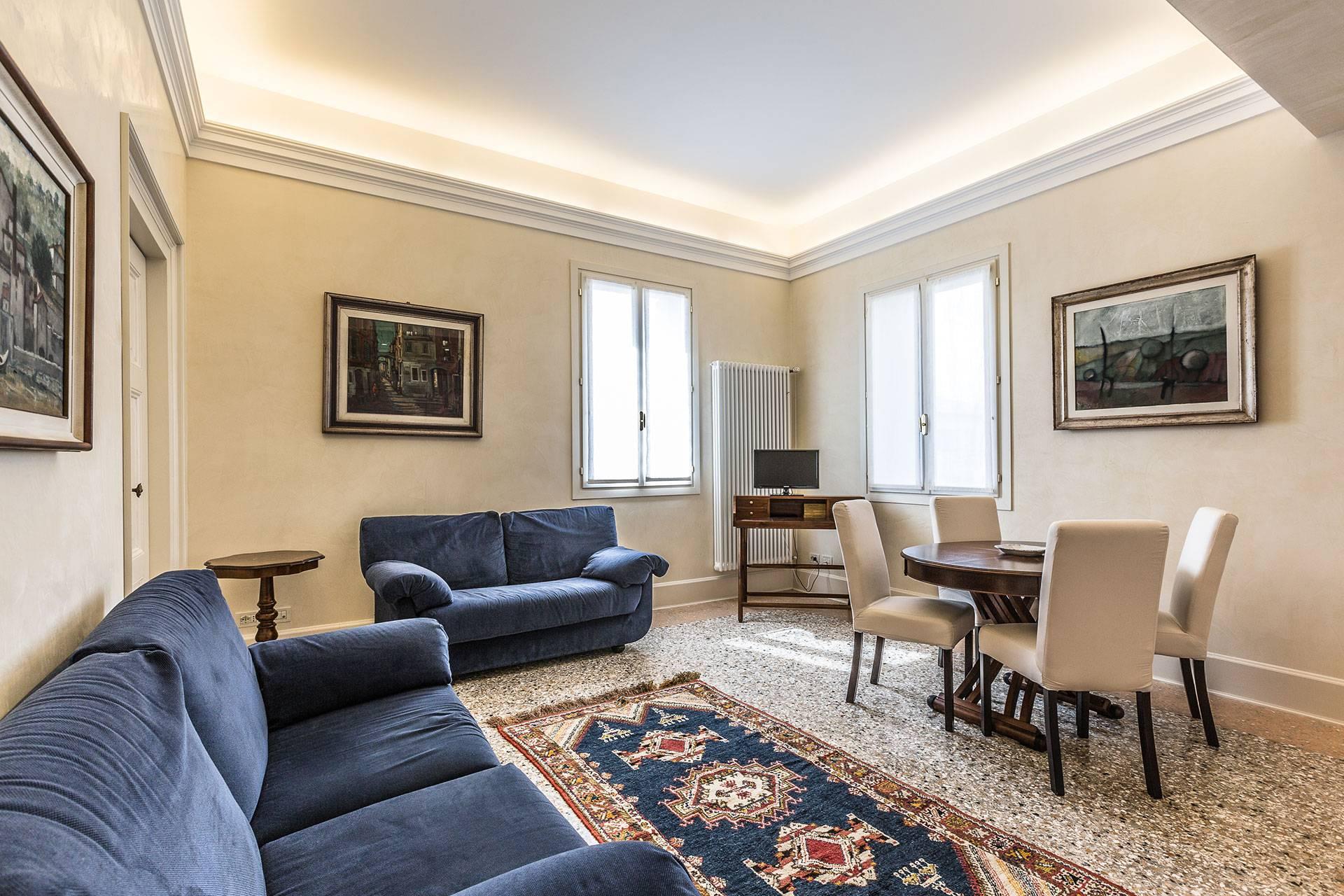 """classic style living room of the Alighieri """"C"""" apartment"""